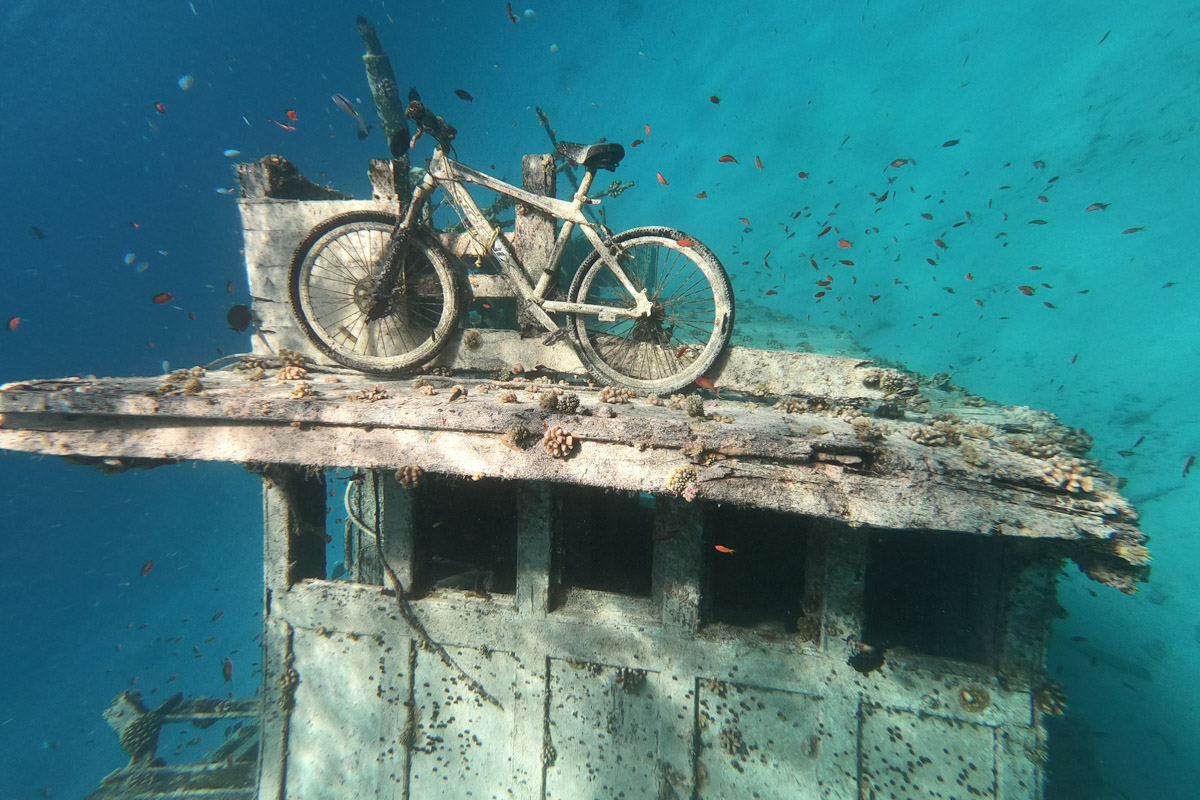 Bike on Keyodhoo wreck - Sailing the Maldives